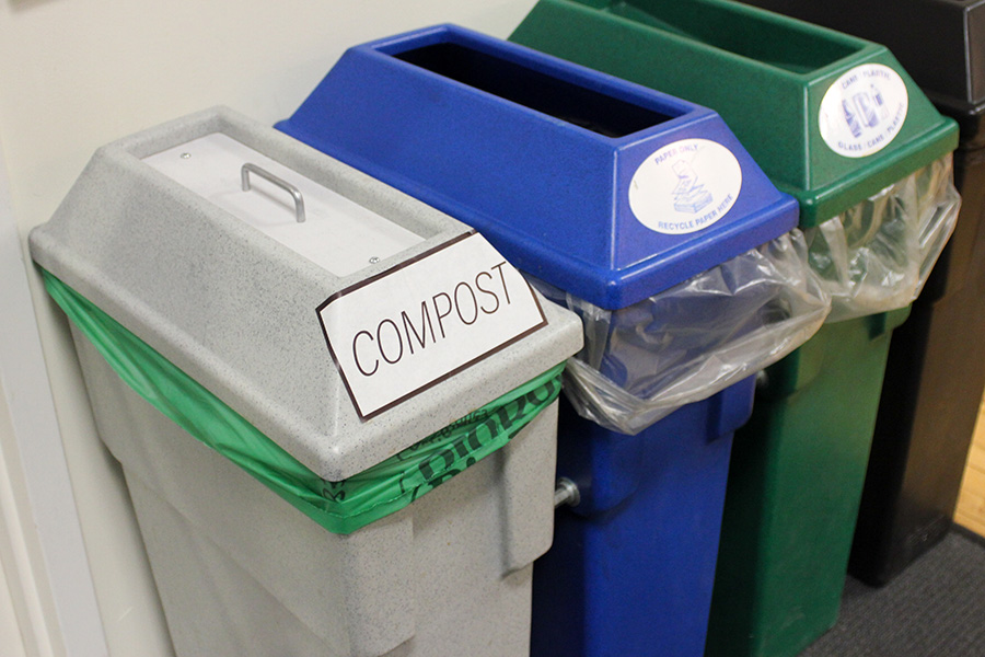 Compost, recycling, and landfill bins in a row