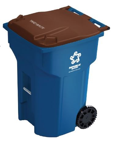 Republic Services bin. A blue wheeled toter with a lid and the Republic Services logo on the side.