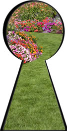 Keyhole shape with a green lawn and flowers visible through it