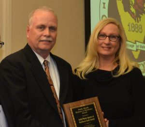 Dave Van Vooren and Mary Allen accepting an award