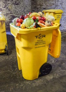 Total Organics Recycling Toter full of food scraps