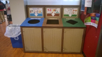 Three bin station including recycling, compost, and landfill bins