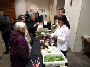Residents interact with info booth staff at Oak Park food waste awareness event