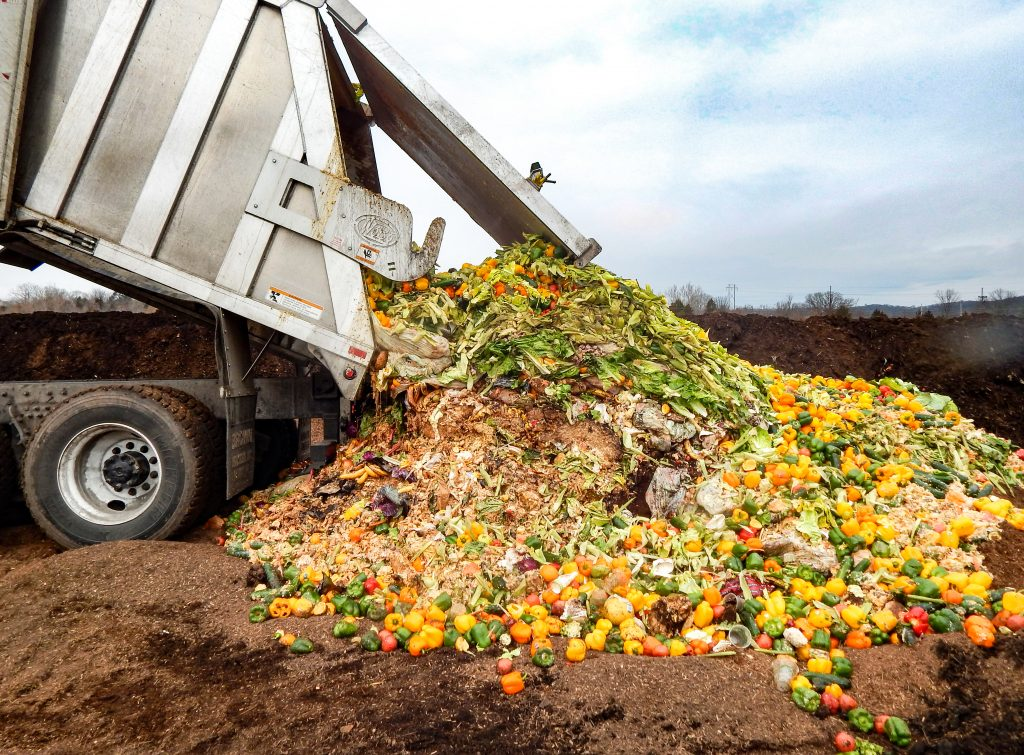 Truck empties food scraps onto ground for composting